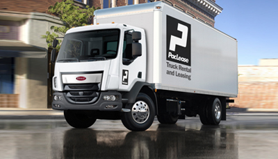 A white commercial truck rental from TLG