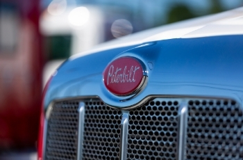 The grill of a shiny Peterbilt truck.
