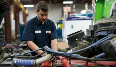 A TLG Peterbilt technician performs heavy duty truck service.